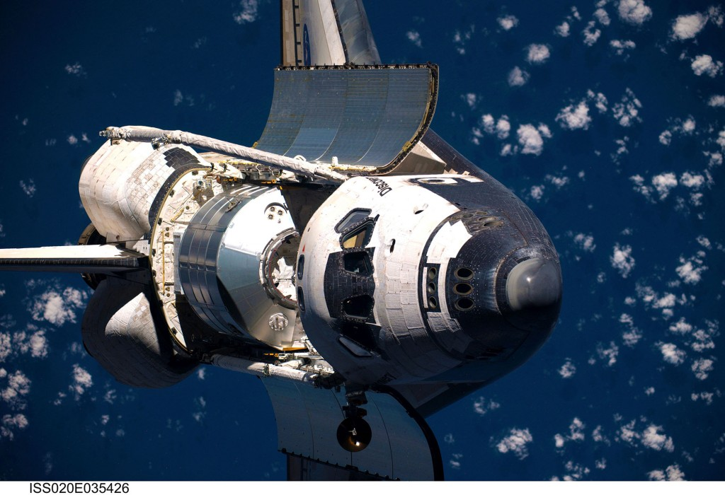 Space_Shuttle_Discovery_before_docking_with_the_ISS