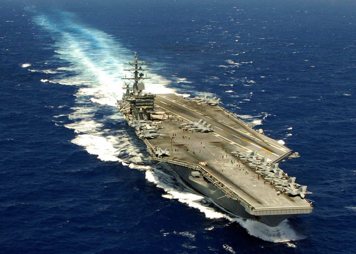 060417-N-0490C-003 Atlantic Ocean (April 17, 2006) - The Nimitz-class aircraft carrier USS Dwight D. Eisenhower (CVN 69) transits the Atlantic Ocean. Eisenhower and embarked Carrier Air Wing Seven (CVW-7) are participating in Composite Training Unit Exercise (COMPTUEX). U.S. Navy photo by Photographer's Mate 2nd Class Miguel A. Contreras (RELEASED)